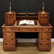 A Victorian walnut twin pedestal writing desk, the superstructure with spindle gallery flanked by