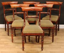 A set of six William IV mahogany bar back dining chairs, each with a curved cresting rail,