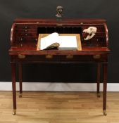 A George III mahogany tambour-fronted writing desk, oversailing top above a retractable front