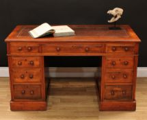 A Victorian walnut twin pedestal writing desk, moulded top with inset tooled and gilt leather