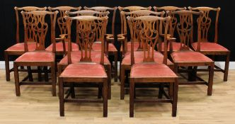 A set of twelve Provincial Chippendale Revival oak dining chairs, comprising a pair of carvers and