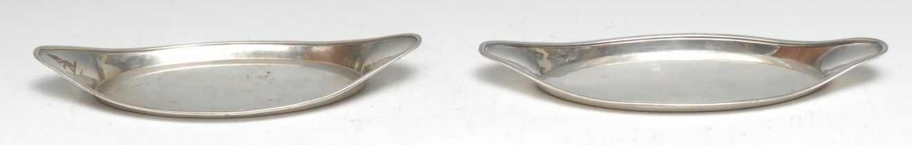A near pair of George III Old Sheffield Plate boat shaped snuffer trays, 26cm and 25cm long, c.1790
