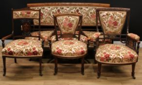 A late Victorian rosewood and marquetry four-piece drawing room suite, comprising a sofa, 85.5cm