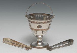 A George III Old Sheffield Plate swing-handled urnular pedestal sugar basket, pierced in the Neo-