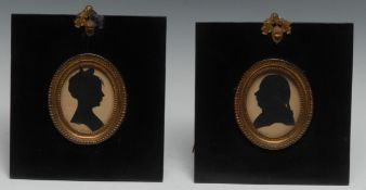 English School (19th/early 20th century), a pair of cut paper silhouettes, of a gentleman and