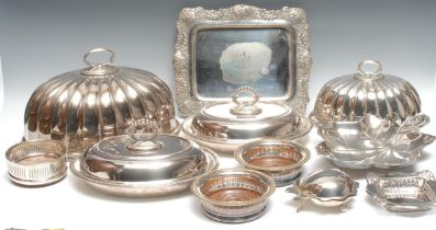 An Edwardian Mappin & Webb meat dome, 35.5cm long; another, 27cm long; entrée dishes, wine bottle