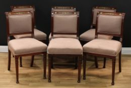 A set of six Empire gilt metal mounted mahogany dining chairs, scroll backs, stuffed over