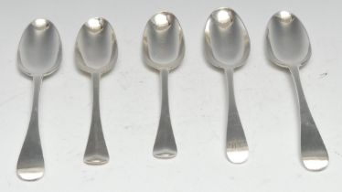 A pair of early George II silver Hanoverian pattern dessert spoons, rat tail bowls, James Wilks,
