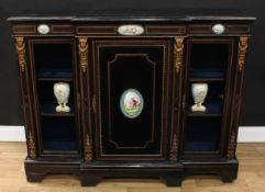 A Victorian gilt metal and porcelain mounted break-centre credenza, slightly oversailing top with