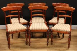 A set of six William IV mahogany bar back dining chairs, drop-in seats, the aprons applied with