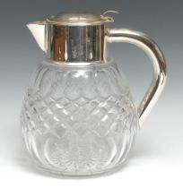 An Edwardian style silver plate mounted clear glass ovoid lemonade jug, hinged cover enclosing a