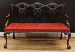 A Chippendale Revival triple chair back sofa, shaped cresting rail, shaped and pierced splats carved