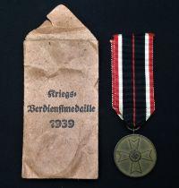 WW2 Third Reich Kriegsverdienstmedaille - War Merit Medal. Complete in original packet of issue with