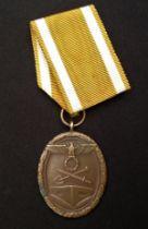 WW2 Third Reich Deutsches Schutzwall-Ehrenzeichen - West Wall Medal. Compete with ribbon. Early