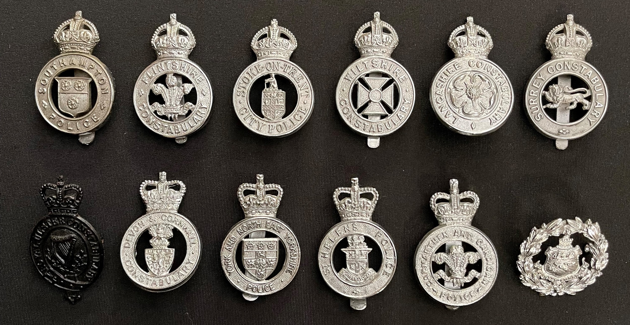 A collection of British Kings Crown and Queens Crown Police Cap badges to include: Kings Crown Stoke