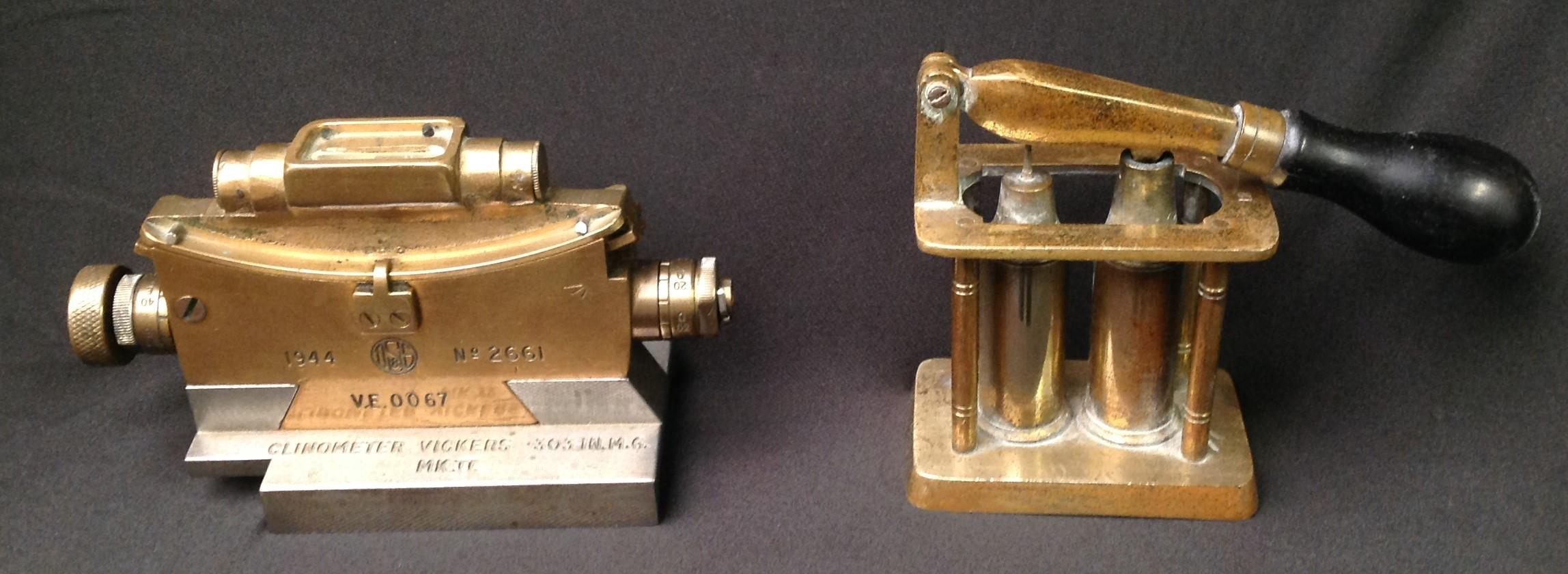 WW2 British Clinometer Vickers .303in MG MKII dated 1944 and a brass 12 Bore Shotgun primer