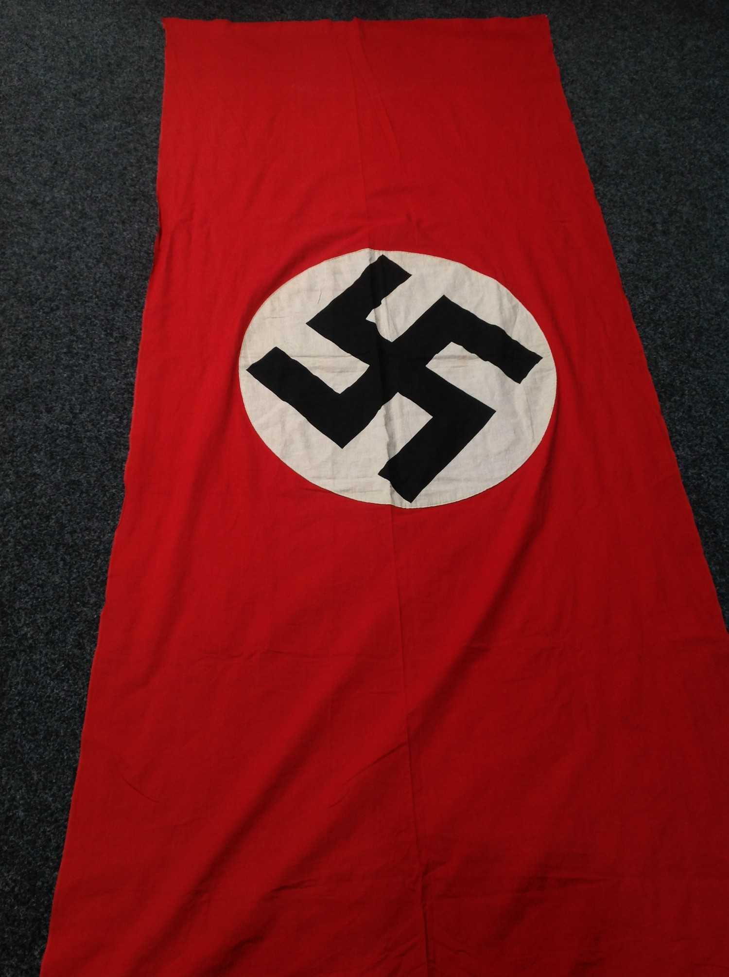 WW2 Third Reich NSDAP Banner, size 280cm x 116cm. Printed Swastika on a separate white roundal. No