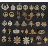 WW2 British Cap badges to include: South Wales Borderers x 2 and Officers Bronze collar dogs: