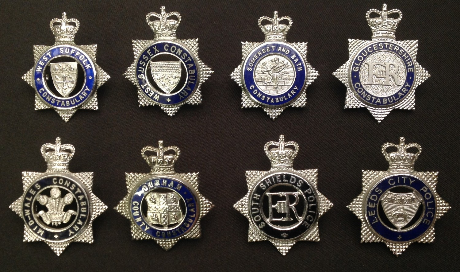 A collection of Queens Crown Police Officers enamelled cap badges: West Suffolk Constabulary: West