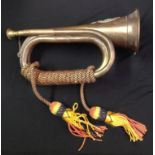Brass and Copper Bugle complete with cords with a Rifle Brigade cap badge affixed.