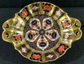 A Royal Crown Derby Imari 1128 pattern two handled pedestal bon-bon dish, solid gold band, 16cm