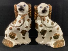 A pair of 19th century Staffordshire King Charles spaniel mantel dogs, copper lustre spots and