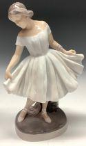 A Royal Copenhagen figure, Ballerina, modelled by Lotte Benter, number 1374, 29.5cm, inscribed,