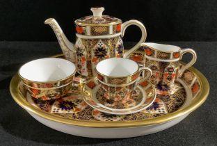 A Royal Crown Derby 1128 Imari pattern miniature tea set, comprising teapot, cream jug, sugar