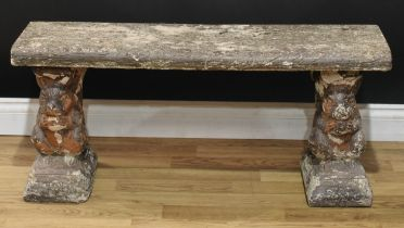 A reconstituted stone garden bench, the end supports cast as squirrels, 44cm high, 101cm wide,