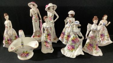 A Staffordshire Fenton floral printed figure, Kate, others, Marie, Manhattan New Yorker, Madeline,