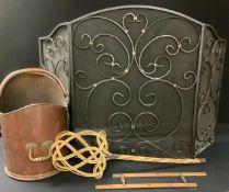 A copper coal scuttle; a black wrought iron fire screen; etc