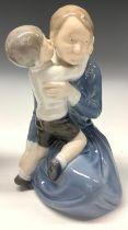 A Royal Copenhagen figure, Mother and Son, modelled by Holger Christensen, number 3457, 21cm,