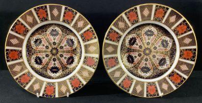 A pair of Royal Crown Derby Imari 1128 pattern dinner plates, 27cm diameter, printed marks, first