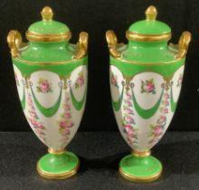 A pair of miniature Minton pedestal two handled vases and covers, printed and painted with