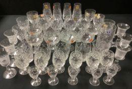 "A set of six Webb Corbett ""Georgian"" wine glasses, six Webb Corbett coupe glasses, four brandy"