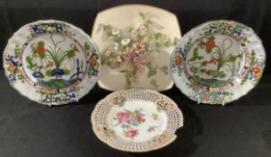 A pair of Continental faience shaped circular soup plates, of 18th century silver form, 25cm wide; a