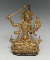 Chinese School, a gilt bronze, Manjushri Tara, seated in meditation with sword, lotus base,