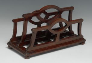 An unusual Edwardian mahogany table top canterbury stationery rack, shaped divisions, bun feet, 31.