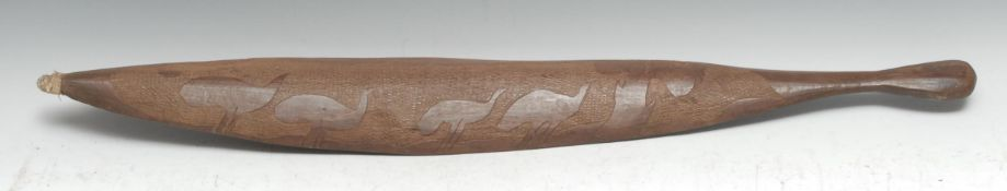Tribal Art - an Australian Aboriginal woomera spear thrower, carved to verso with stylised emu, on a