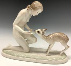 A Hutschenreuther figure, Gute Freunde, female nude with fawn, modelled by Carl Werner, 32cm wide,