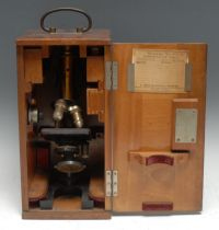 An Ernst Leitz lacquered brass and black-enamelled compound monocular microscope, serial no. 104826,