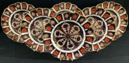 A set of six Royal Crown Derby Imari 1128 pattern shaped circular dessert plates, 22cm, printed