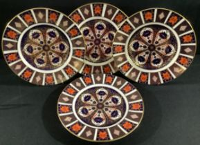 A set of four Royal Crown Derby Imari 1128 pattern dinner plates, 27cm, printed marks, first quality