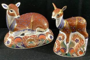 A Royal Crown Derby paperweight, Collectors Guild, Deer, gold stopper, boxed; a similar fawn (2)