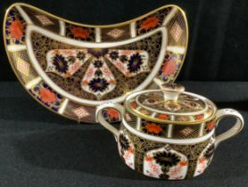 A Royal Crown Derby Imari 1128 pattern sucrier and cover, an 1128 crescent shaped salad dish,