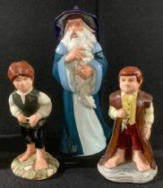 A set of three Royal Doulton The Lord of the Rings Middle Earth figures, Gandalf HN2911, Bilbo