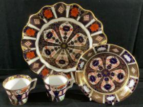 A Royal Crown Derby Imari 1128 pattern shaped circular dessert plate, 22cm diameter, printed