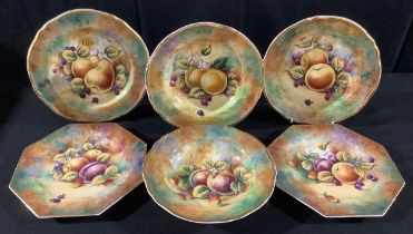 A pair of Staffordshire Phildale octagonal cabinet plates, painted by P Worsdale, signed,