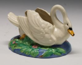 A Clarice Cliff posy holder modelled as a swan swimming on an oval lily pad pond, printed mark, 26cm