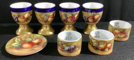 A set of four Durley Porcelain egg cups, by James Skerrett, signed, painted with ripe peaches and